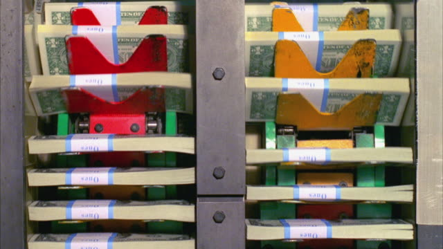 CU, Stacks of American one dollar bills moving on elevator, Washington DC, USA