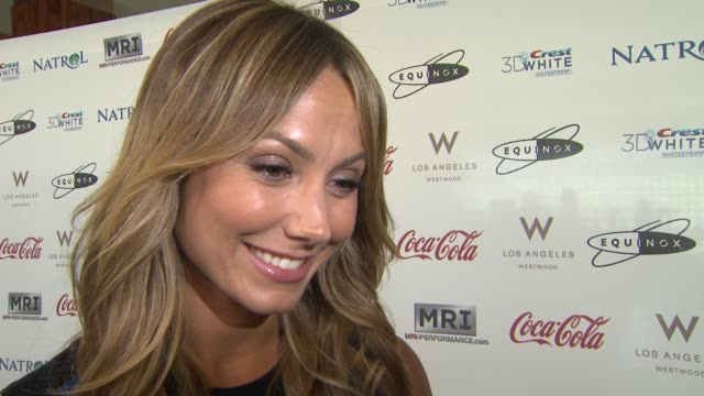 INTERVIEW Stacy Keibler on being here on what actors and actresses have in common at CW3PR Presents Gold Meets Golden At Equinox Sports Club Hosted...