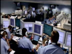 RAF staff sitting at computers in master control room monitoring civil airline routes against terrorist attacks England; 2005