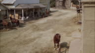 WS CS PAN Stagecoach riding through town