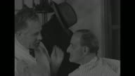 Staged reactions to news of Italian surrender in World War II / VS barber cuts man's hair SOT in heavy accent 'I'm telling you Italy's through...