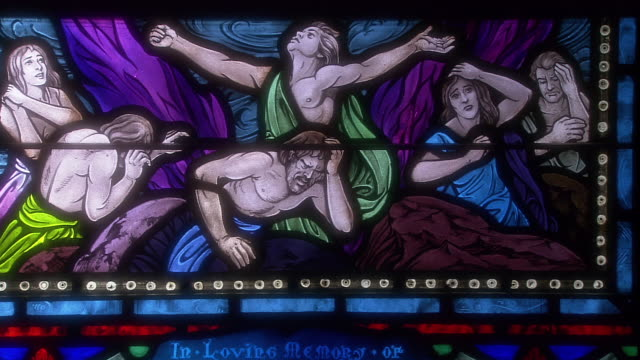 Stained glass depicts a religious scene.