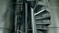 Staircase in liquid storage with aluminum barrels