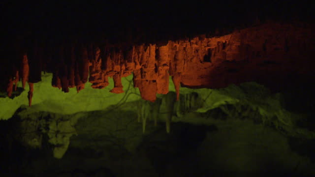 MS, Stalactites illuminated with colorful lights in underground cave, Playa del Carmen, Quintanaroo, Mexico