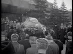 Stalin funeral march procession with coffin entering Mausoleum street parade at Red square / Moscow Russia AUDIO
