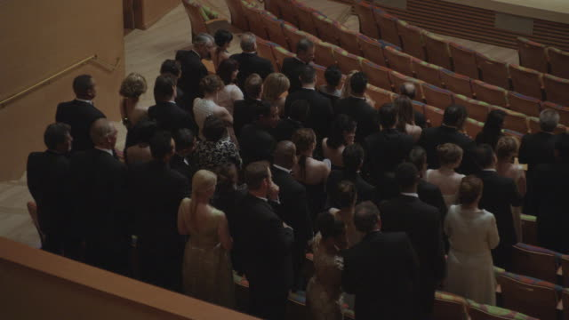 MS Stand audience applauding in formal attire in various sections of concert hall