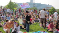 Standing in a sea of Grateful Dead fans on a lawn outside Soldier Field a woman holds a sign reading 'Jerry is watching be kind' in reference to the...