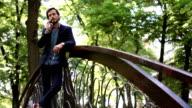 Standing on bridge in park