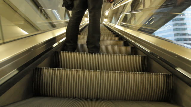Standing on Escalator going up