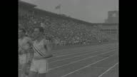 Start of 800 meter race at USJapan track meet in Tokyo with two US runners two Japanese runners / four men race / four men race to finish line / CU...