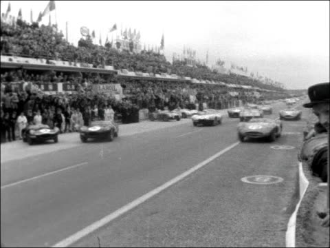 Start of Le Mans race FRANCE Le Mans EXT LS Crowd / MCU Two drivers / MU Stirling Moss / MCU Two drivers shake hands one is Hawthorn who stands ready...