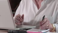 Start up business, Man in Dining Room with laptop, tilt up, writing, thinking, typing.