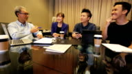 Startup Asian Business Entrepreneurs With Mentor in Meeting