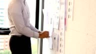 Start-up Meetings : Businessman take a planning and appointment on sticky notes.