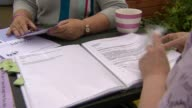 State pension reform leaves 1m women poorer ENGLAND EXT Various of Cheryl Parker Tricia Gough and Joan Lyegreen at table looking at documents Joan...