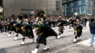 NY State Police bagpipers march down 5th Avenue in NYC during the 2015 St Patrick's Day Parade