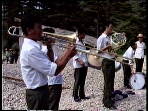 State propaganda brass band play at building site as construction work continues North Korea Aug 88