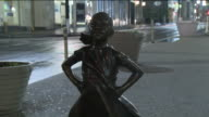 WPIX State Street Global Advisors installed a statue of a defiant girl with hands on her hips chin high and pony tail out in front of the charging...