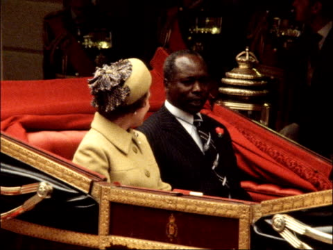State visit by President of Kenya ENGLAND London Victoria Station Daniel Moi and Queen Elizabeth II stand MS Queen and Moi in open carriage GV...