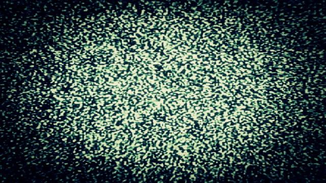 TV Static fills the screen (Loop).