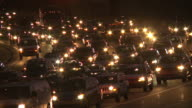 Static, medium shot of traffic at night in Atlanta, Georgia.