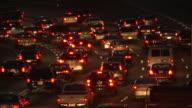 Static, rack focus shot of traffic at night in Atlanta, Georgia.