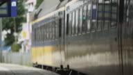 Static shot of a train leaving a train station