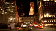 Static shot of buildings along Central Park South in Grand Army Plaza lit up at night
