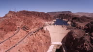 Static shot of hoover dam with cars driving.