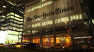Static shot of the New York Times building at night