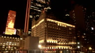 Static shot of The Plaza Hotel lit up at night as seen from Grand Army Plaza in Midtown Manhattan