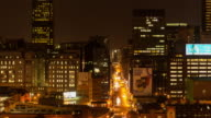 Static timelapse at night of the nightlife, traffic and people buzzing in Johannesburg, South Africa