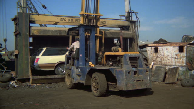WS ZI MS Station wagon being crushed at junkyard