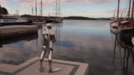 A statue of a diver at the Oslo Norway harbor.