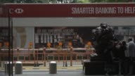 A statue of a lion sits at the HSBC Holdings Plc headquarters building in Hong Kong China on Saturday July 29 2017 People pass in front of a statue...