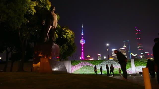 Statue of Chen Yi, Shanghai's first Mayor and The Bund skyline - Shanghai, China