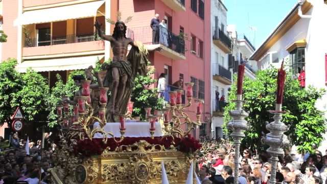 Statue of Jesus Christ being carried by Costaleros bearing a Trono a religious procession through the streets of Malaga, Spain, Europe