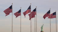 Statue of Liberty and US Flags, New York City, USA