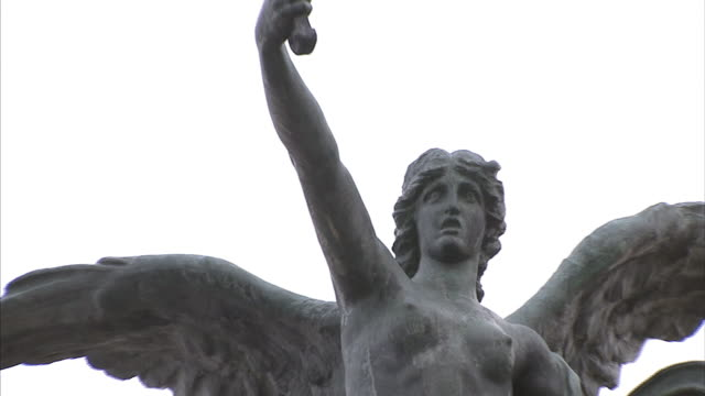 A statue of Michael the Archangel depicts him holding a sword aloft.