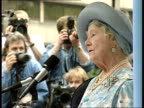 Six protesters arrested ENGLAND London Strand EXT Side view Queen Mother making speech as protesters shouting interrupts her SOT Police amidst crowd...