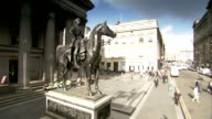 A statue of the Duke of Wellingotn on horseback stands in front of the Glasgow's Gallery of Modern Art. Available in HD.