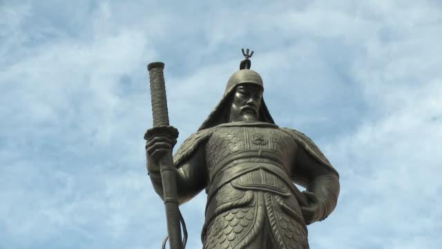 T/L LA MS Statue of Yi Sun-sin admiral against sky / Seoul, South Korea