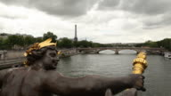 MS Statue on Pont Alexandre III with Eiffel Tower in distance / Paris, France