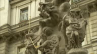 Statues depict scenes of the 1679 plague on the Pestsäule in Vienna. Available in HD.