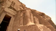 Statues of Ramesses II flank the entrance to the Abu Simbel Temple. Available in HD.