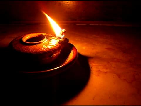 Steady on Oil Lamp Burning in Dark Room
