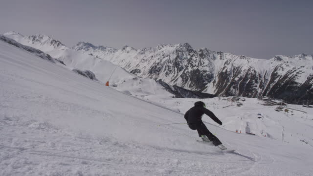 Steady shot of downhill skier.