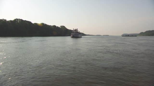 WS POV Steam boat moving in Hannibal Mississippi river / Hannibal, Missouri, United States