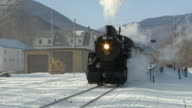 ZO CU Steam engine 7470 passing station, Winter landscape, Bartlett, New Hampshire, USA