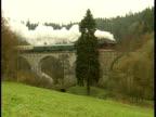 Steam engine crossing bridge